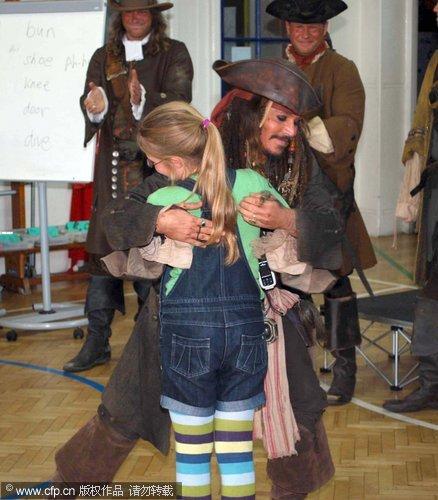 Johnny Depp makes surprise school visit in pirate gear