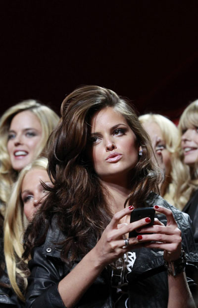 Victoria's Secret models pose at a preview for annual Fashion show
