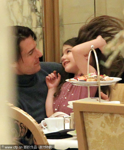Tom Cruise and Suri share an intimate family moment at the Palm Court