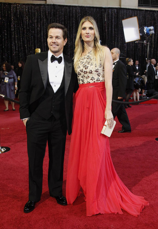 Mark Wahlberg arrives with his wife Rhea Durham at the 83rd Academy Awards in Hollywood
