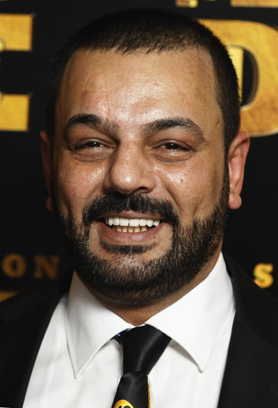 Latif yahia poses for photographers at the british premiere of the