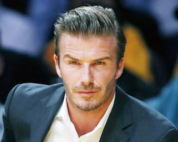 British soccer star David Beckham sits courtside as the Los Angeles ...