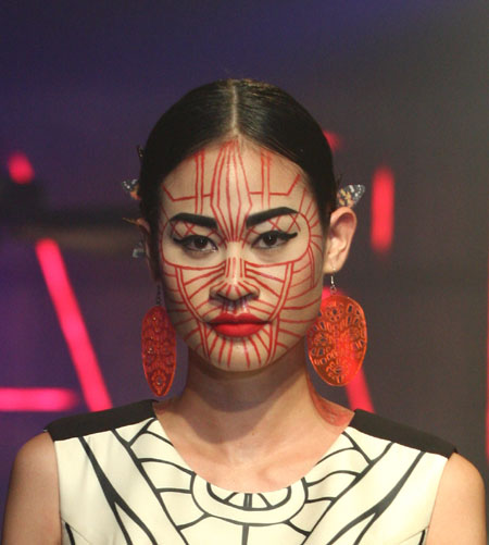 0a4981fbd Tribal chin chic. A model with a facial tattoo depicting women ...