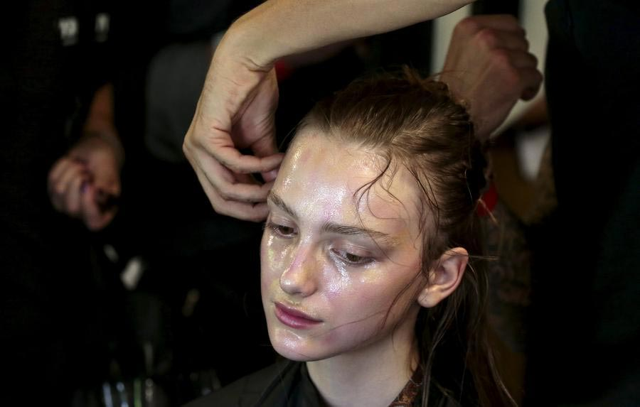 A model has her makeup done backstage before the presentation of the Vivienne Westwood Red Label Spring/Summer 2016 collection during London Fashion Week in ...