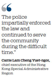 Carrie Lam commends 'professionalism and restraint' of HK police