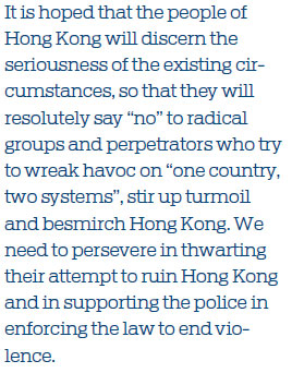 Support HK police in enforcing the law to stop violence