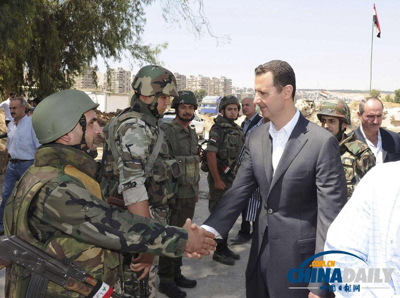 潘基文/叙利亚总统阿萨德视察政府军队