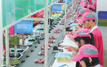 workers assemble toys in chenghai the district now ...