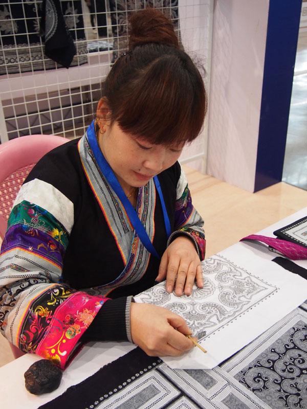 above cai qun draws pattens for a batik design at her workshop at dazhai village zhijin county. Black Bedroom Furniture Sets. Home Design Ideas