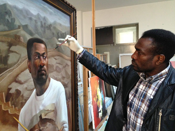 congolese painter theodore akonga touches up a self portrait that explores retaining a sense of. Black Bedroom Furniture Sets. Home Design Ideas