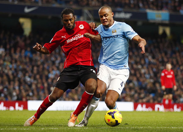 manchester city s vincent kompany right challenges cardiff