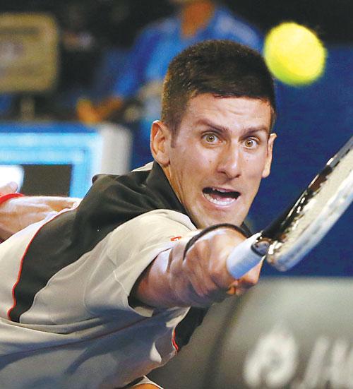 Novak Djokovic Lunges For A Return Against Fabio Fognini