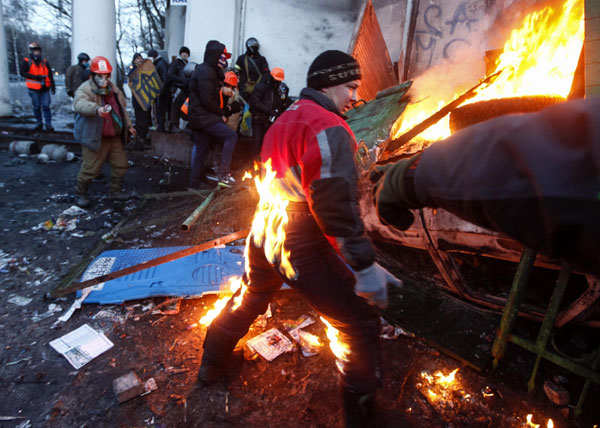 a pro european integration protester catches fire during clashes with police in kiev on monday