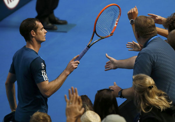 andy murray gives his smashed racket to a fan during his
