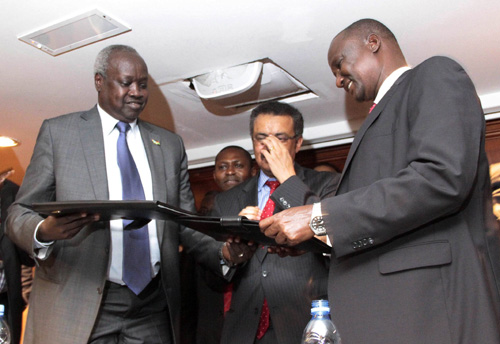 the leader of the south sudan s government delegation nhial deng nhial left exchanges a signed