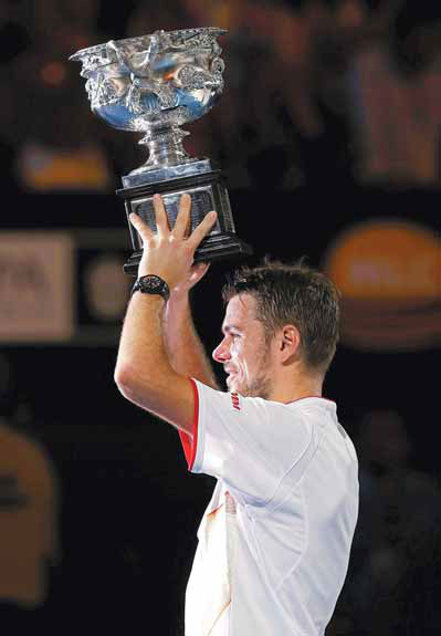 stanislas wawrinka poses with the norman brookes challenge