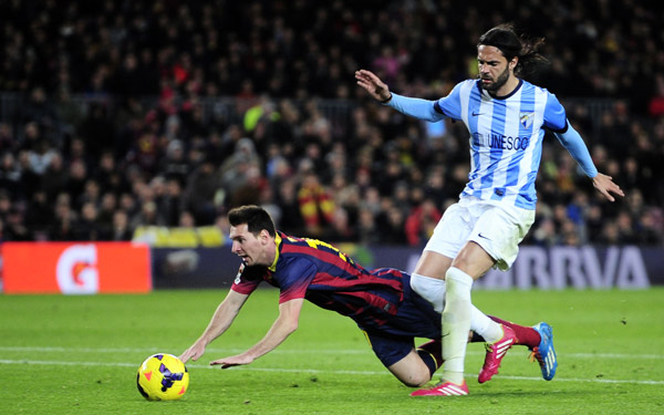 barcelona s lionel messi takes as spill challenging malaga