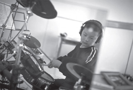 chao chao a fourth grader with autism practices electronic drums for a ...