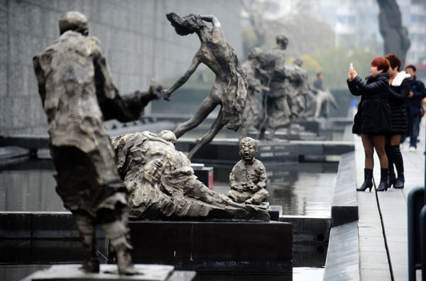 Tourists visit the memorial hall of the victims of the nanjing