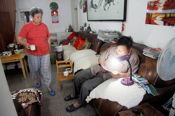 Hu Dehua 67 And Her Husband Chen Fang At Their Home In
