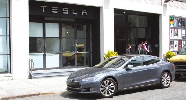 A Tesla Model S Sits Outside Of A Tesla Motors