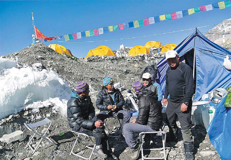 Sherpas sit at the base c after a qomolangma expedition was