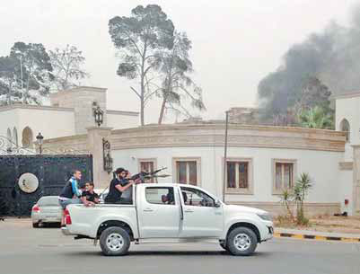 Armed men patrol the streets of tripoli libya near the for Farcical scenes over abbott s wild party