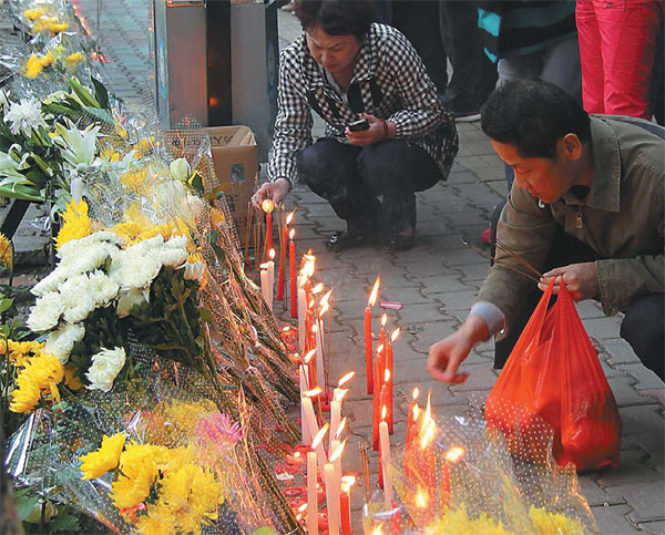 Residents Mourn In Urumqi On Friday For Victims Of The