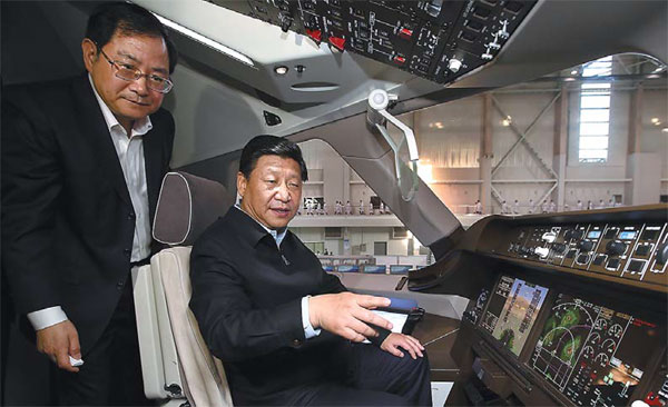 xi jinping boards a demonstration prototype of the c919 during an