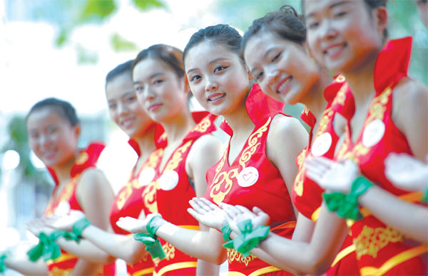 Members Of The Green Ribbon Volunteer Group Serve As
