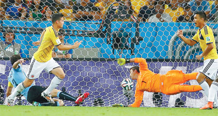 james rodriguez right scores his second goal for colombia past