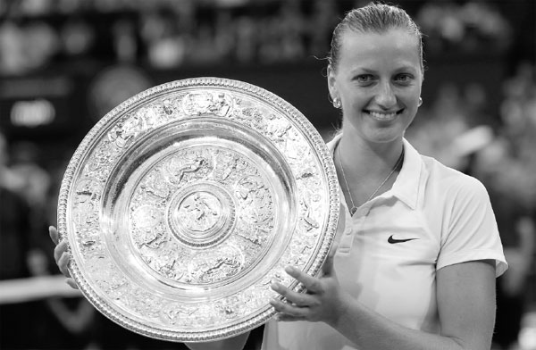 petra kvitova holds the champion s silver tray after defeating eugenie bouchard in the women s