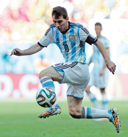 lionel messi leaps to corral a pass during argentina s