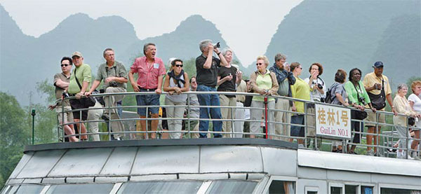 Foreign Tourists Appreciate The Lijiang River Views On A Sightseeing Boat