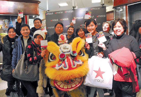 chinese shoppers show the discount cards that macy s ...