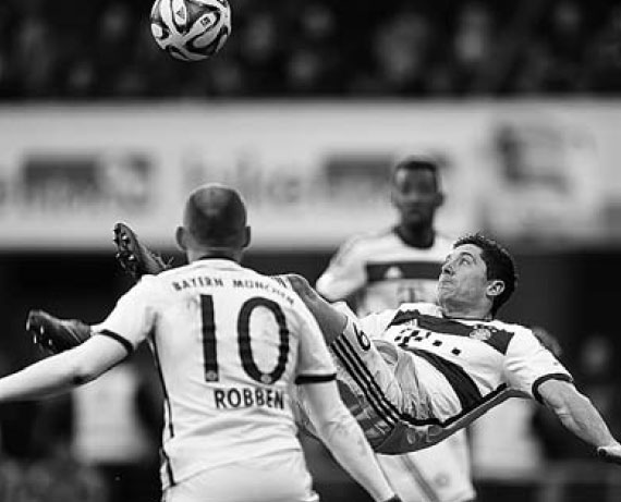 Bayern Munich Striker Robert Lewandowski Vies For The Ball