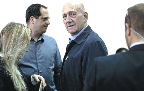 Former Israeli Prime Minister Ehud Olmert Center Waits To