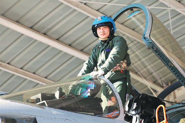 Pilot Zhang Chao Poses For A Photo Before Flying A J 15