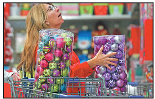 A Shopper Looks At Ornaments At A Walmart Store In Los