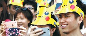 People Wearing Pikachu Hats Take Pictures Of The Parade By