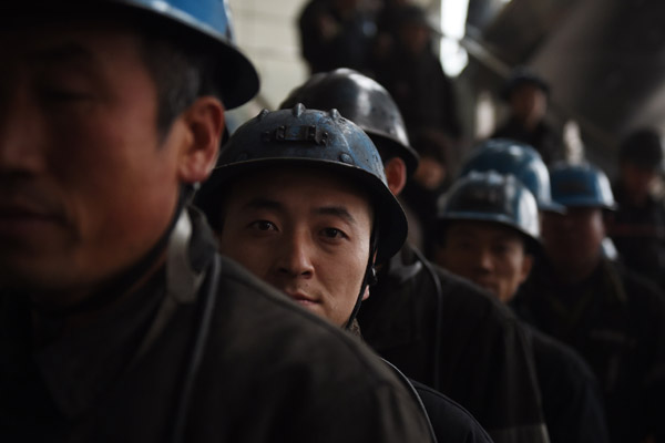 Miners Wait To Enter The Tashan Coal Mine Near Datong In