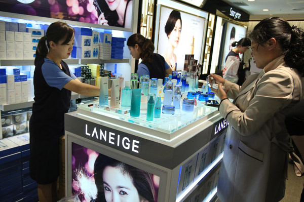 chinese shoppers choose cosmetics products at a duty free ...