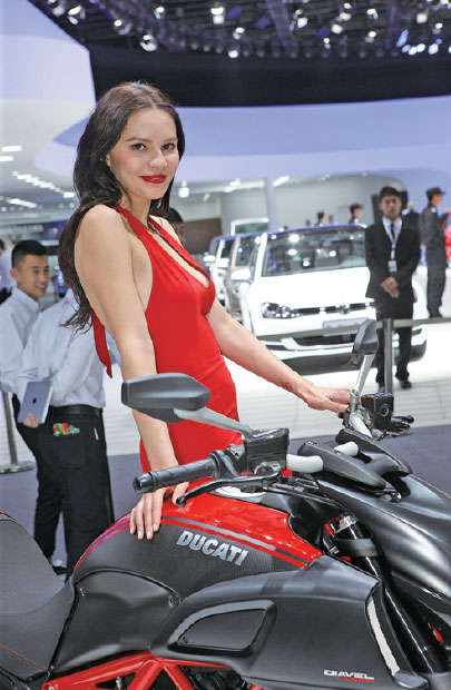 A Model Stands Beside A Ducati Motorcycle During A Recent