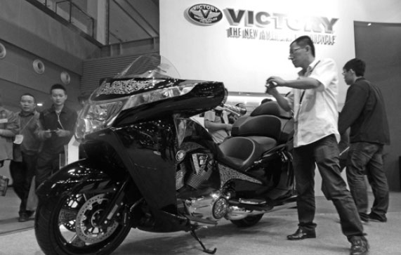 A Man Takes Photo Of A Victory Branded Motorcycle During An Auto Show In Chongqing Zhou Hui For