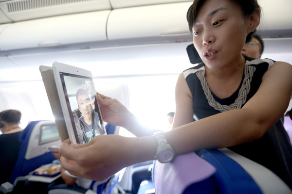 a passenger uses the wi fi service on a china eastern ...