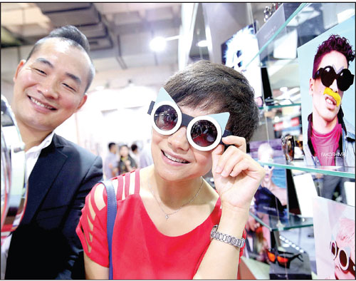 A Visitor Tries On A Stylish Uvlight Protective Glasses At