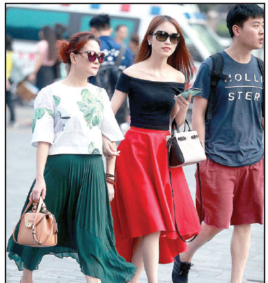 Two Women Wearing Trendy Sunglasses Enter The Bustling