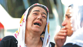 Women Mourn As They Wait In Front Of A Hospital Morgue In The Turkish City Of Gaziantep Where A