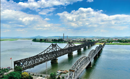 The Bridge On The Right Across The Yalu River In Dandong