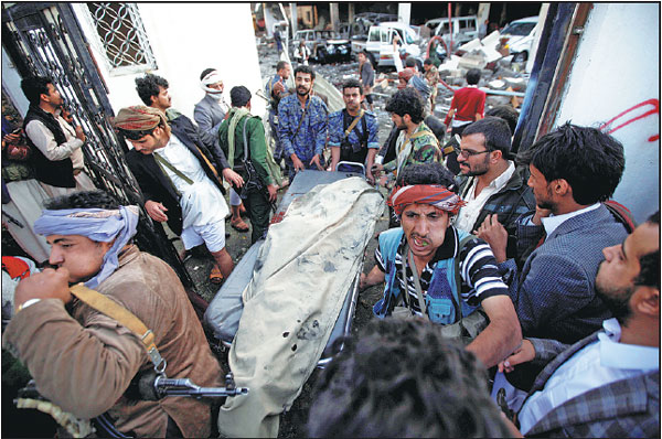 People Carry The Body Of A Man Killed In An Airstrike On